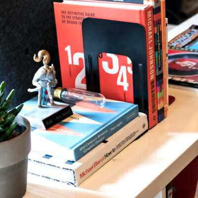 Six digital marketing agency books about marketing strategy stacked neatly