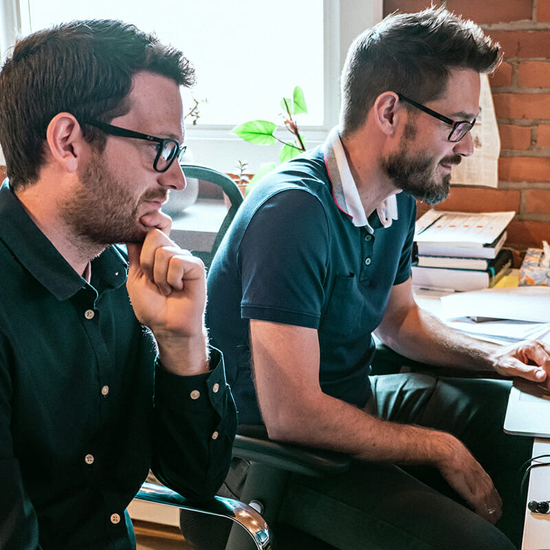 Two web developers work together on app development